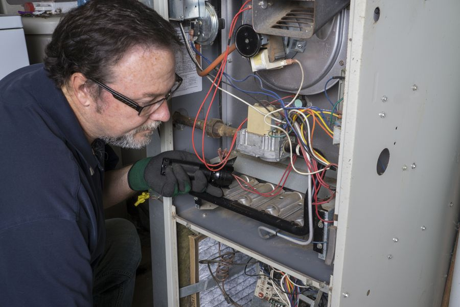 HVAC Contractors fixing a furnace